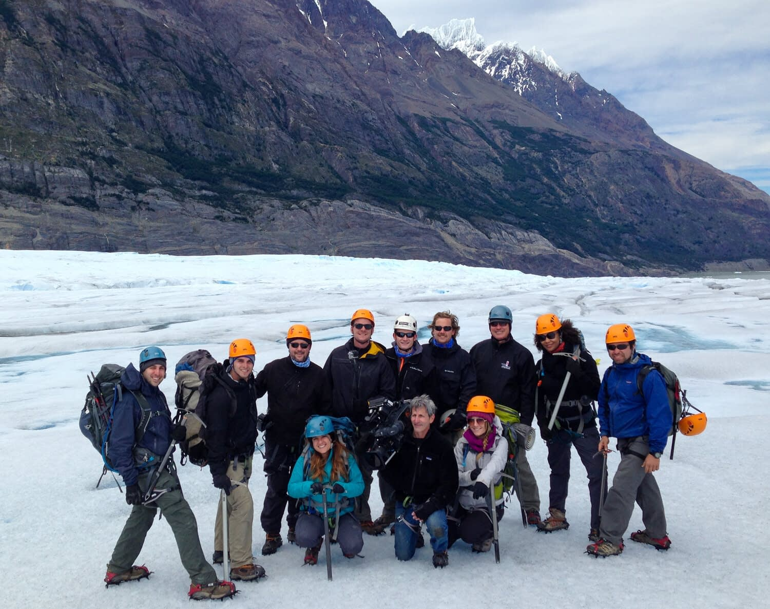 Philipp (top, center) pictured in Chile with the Moments of Happiness production crew